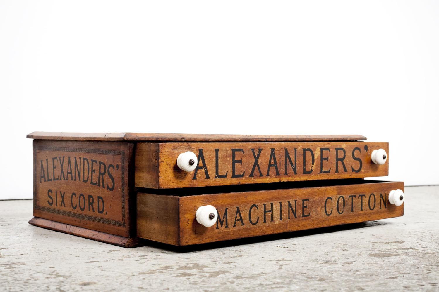 Antique two drawer shop display cabinet for Alexanders' Machine Cotton