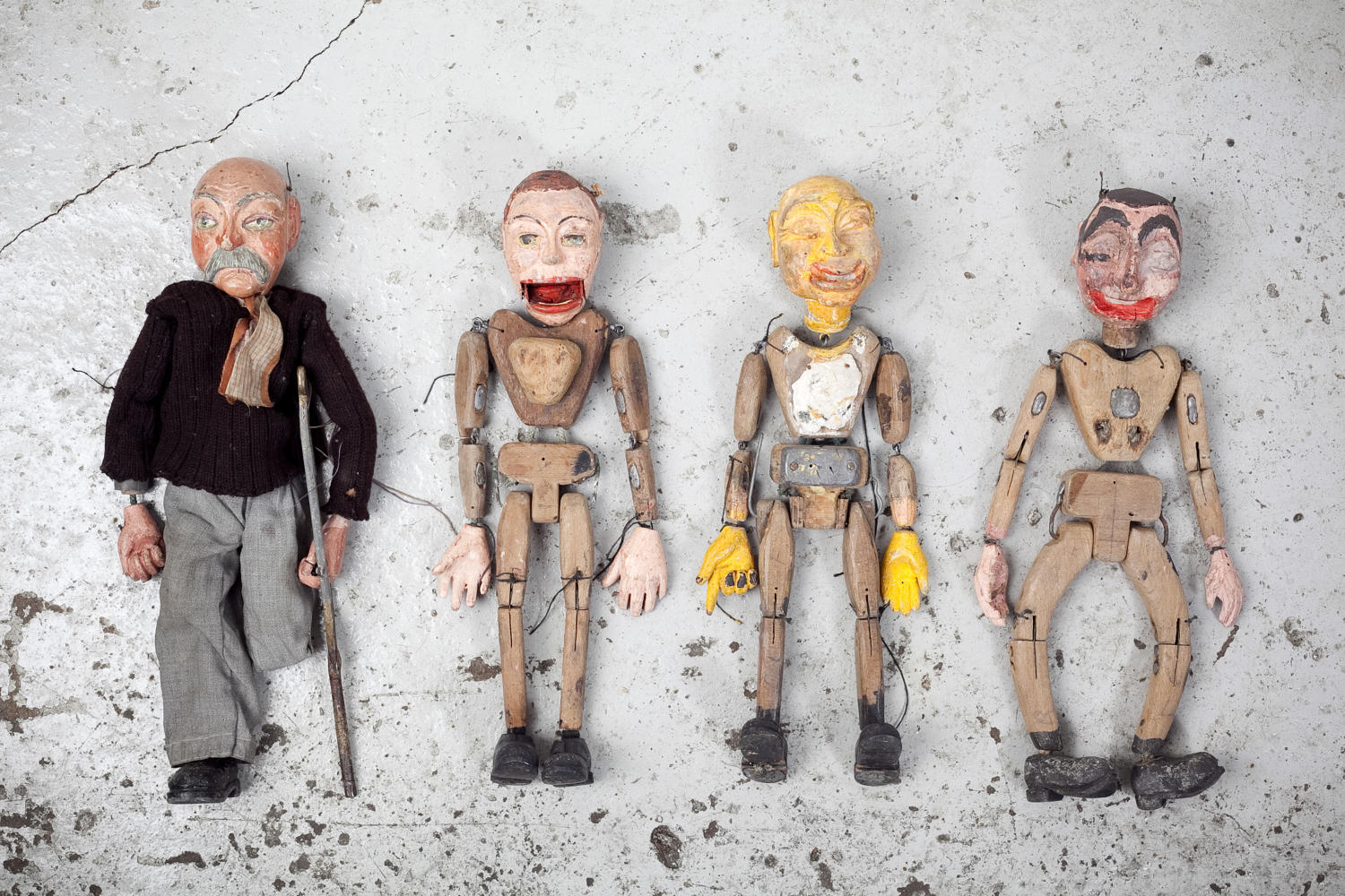 A set of four articulated puppets