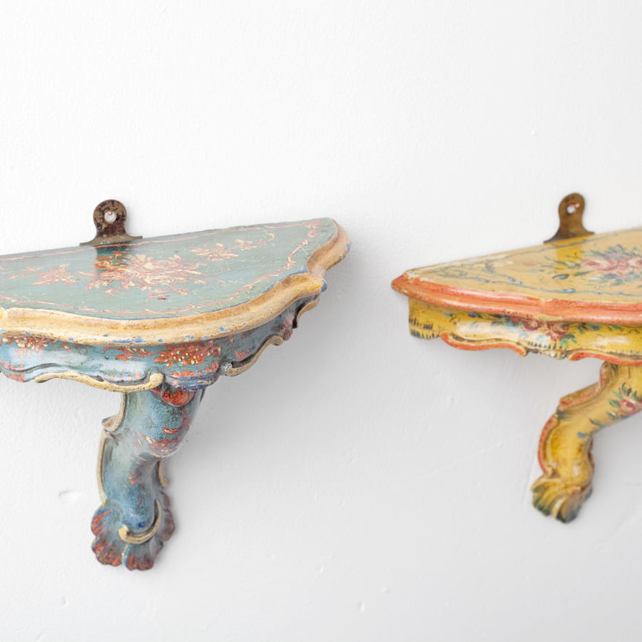 A pair of French hand-painted wall bracket shelves