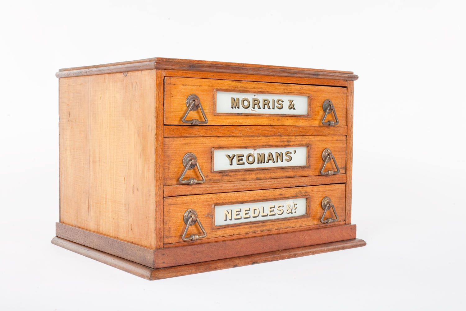 Early 20th century display cabinet for Morris and Yeomans' Needles