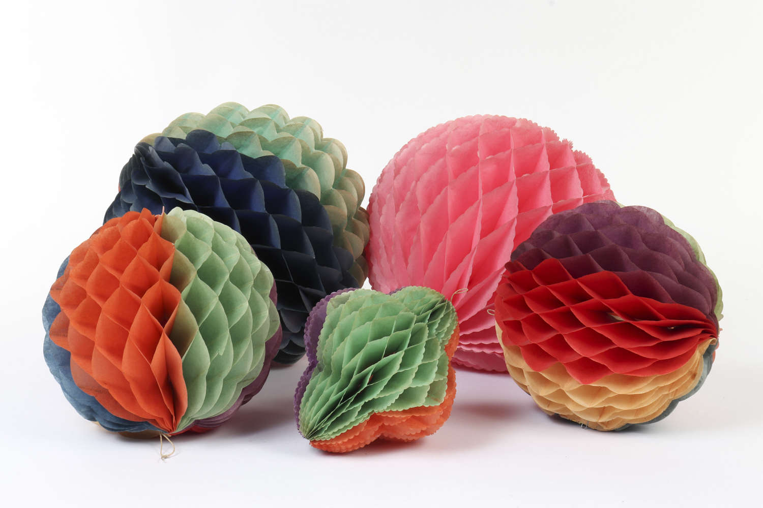Five vintage honeycomb paper decorations