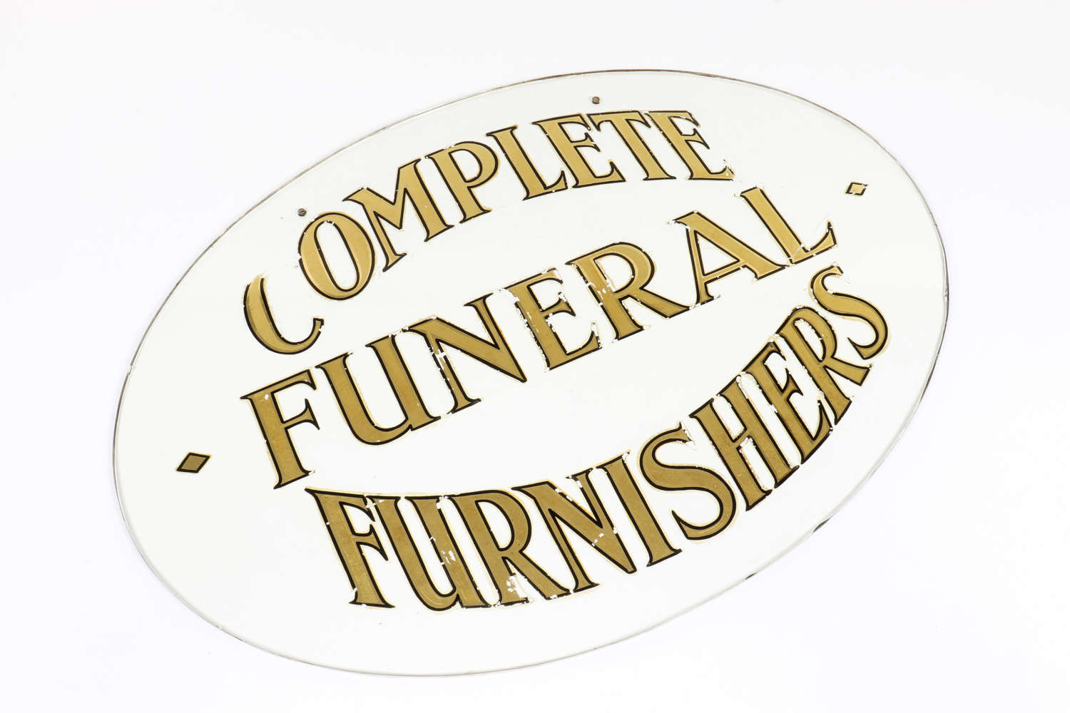 'Complete Funeral Furnishers' glass sign.