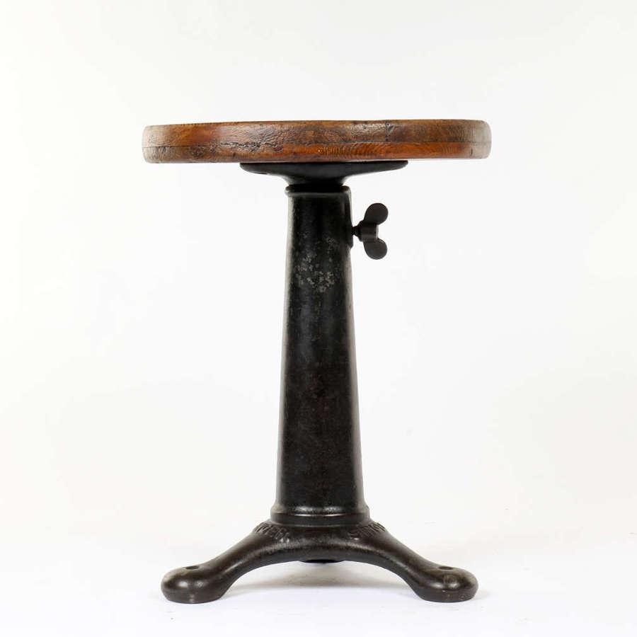 Vintage industrial work stool by Singer